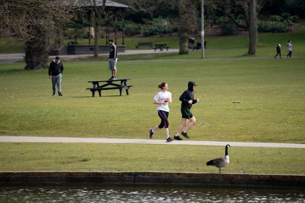 People exercise in Cannon Hill Park in Birmingham