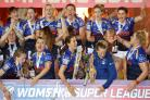 Leeds Rhinos players celebrate with the Women's Super League trophy (Action Images/Ed Sykes)