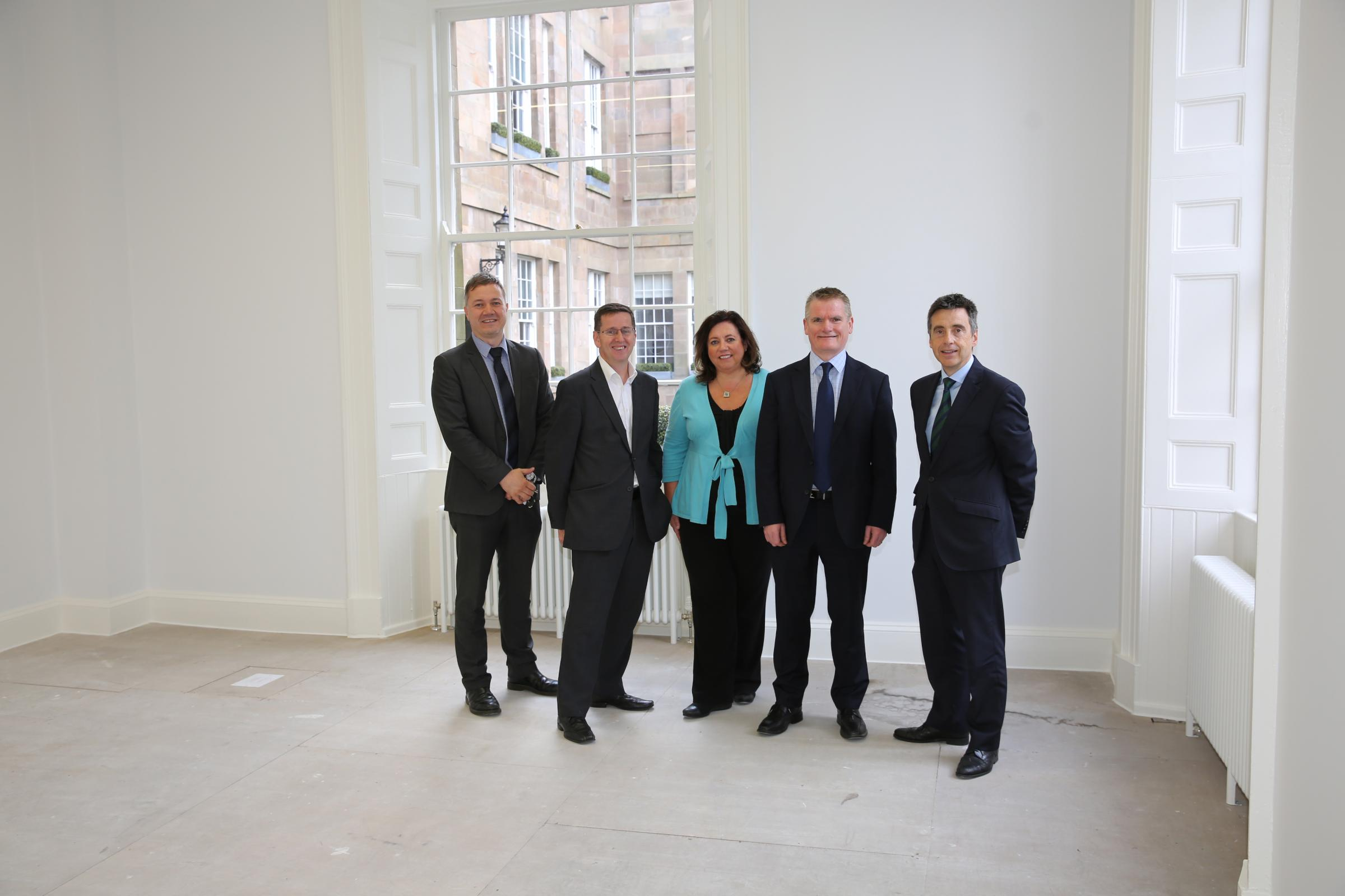 Greenock Custom House progress is looked at by David Martin from Riverside Inverclyde, Councillor Jim Clocherty, Fiona Maguire, RI chairman Gerry McCarthy and RI chief executive Aubrey Fawcett.