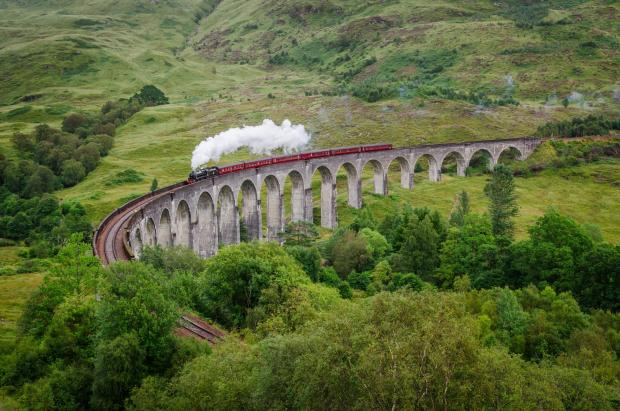 Greenock Telegraph: View of a steam train on a famous Glenfinnan viaduct, Scotland; Shutterstock ID 154641122; PO: THE HERALD MAGAZINE ; Job: TRAVEL