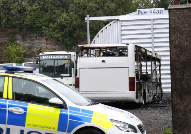 Police at the scene of the blaze which destroyed seven vehicles in the Wilson's Buses depot in Greenock. Picture: George Munro