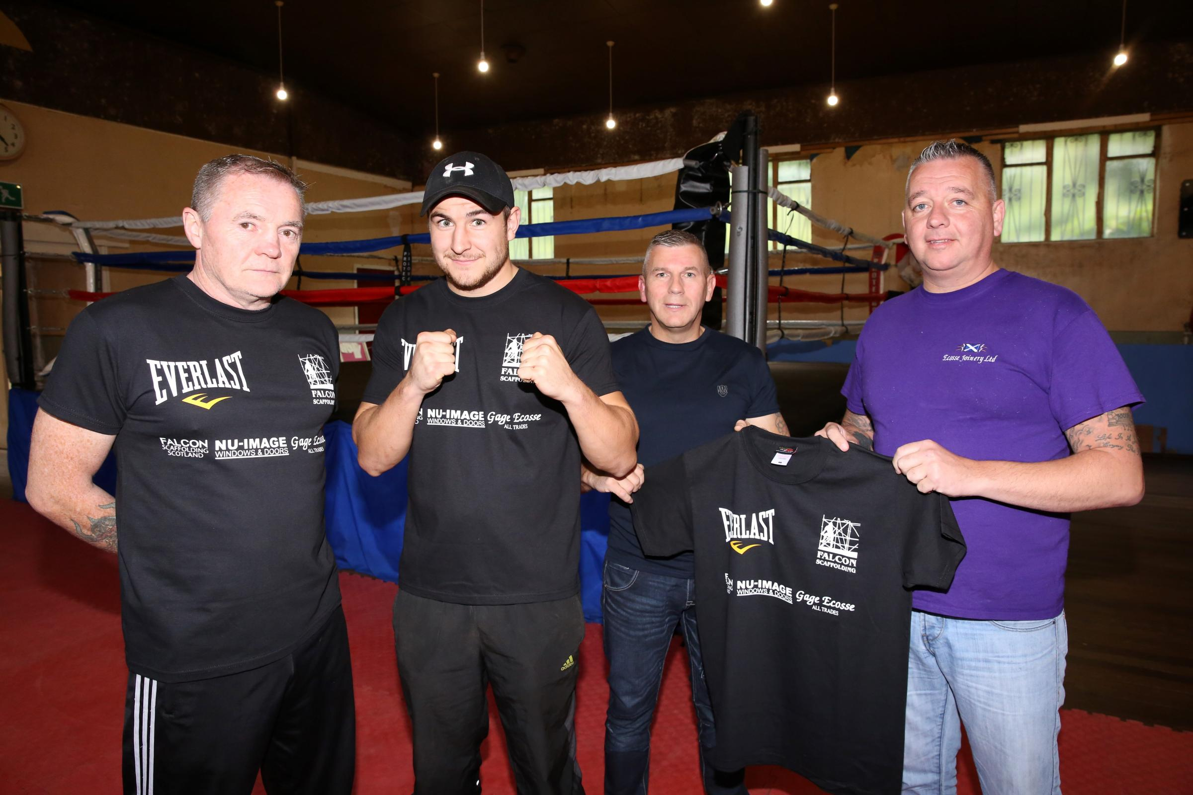 Pictured from left to  right are coach Kenny Crighton, boxer  Grant Quigley, Billy McPherson, boss of Nu  Image, and Scott Gage, owner of Gage  Ecosse Joinery. Picture: George Munro.