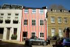 Red and white striped house can stay after woman wins court battle