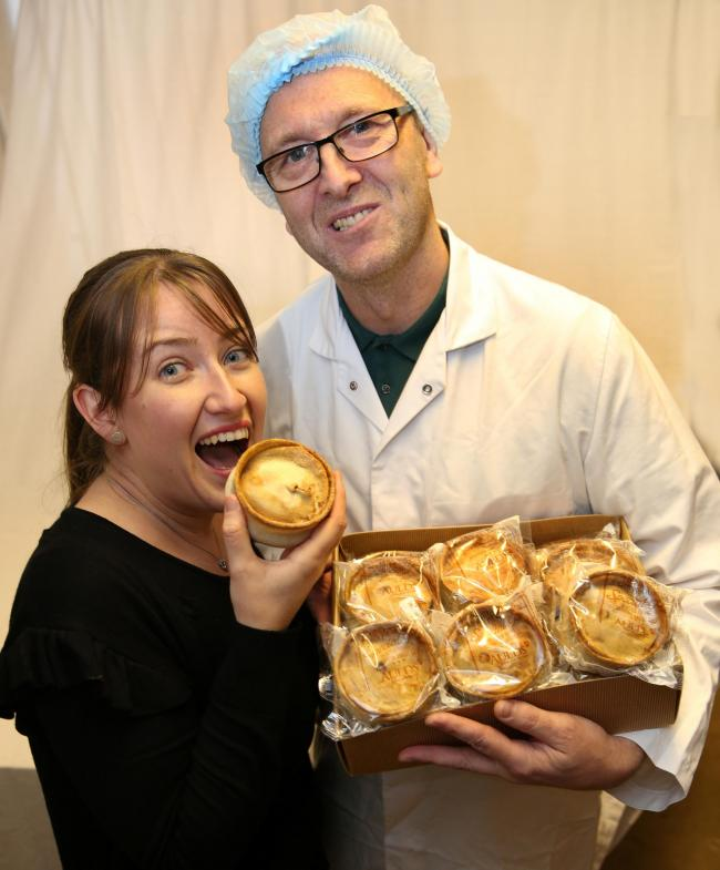 Auld's supervisor Jennifer Small tucks in to a treat with foreman Sam McVicar.Photo: George Munro