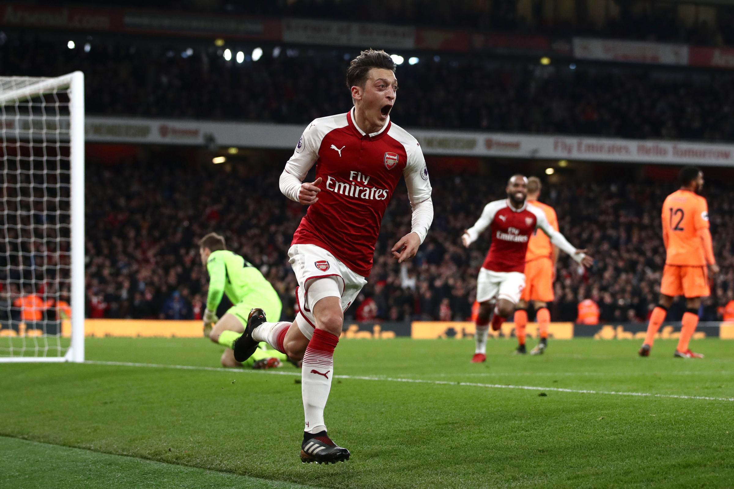 Arsenal's Mesut Ozil celebrates scoring his side's third goal of the game during the Premier League match at the Emirates Stadium, London. PRESS ASSOCIATION Photo. Picture date: Friday December 22, 2017. See PA story SOCCER Arsenal. Photo credit shoul