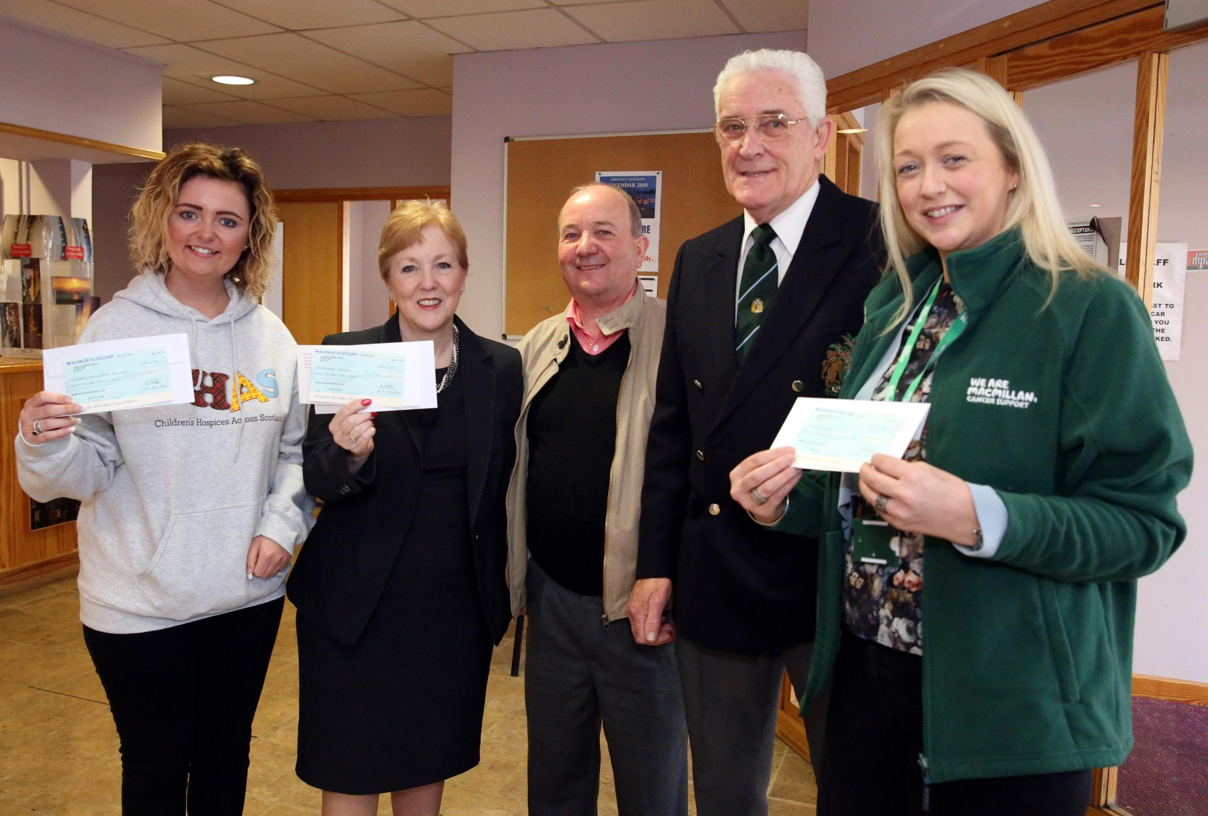 Dockers Club cheques to charities. From left are Samantha Reilly, CHAS, Linda McEnhill, chief executive of Ardgowan Hospice, Jim Molly Dockers secretary, Neil Paton, treasurer, and Cara Inglis from Macmillan Cancer Care.