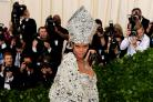 Rihanna stood out at the Met Gala in a stunning dress inspired by the Pope (Ian West/PA)