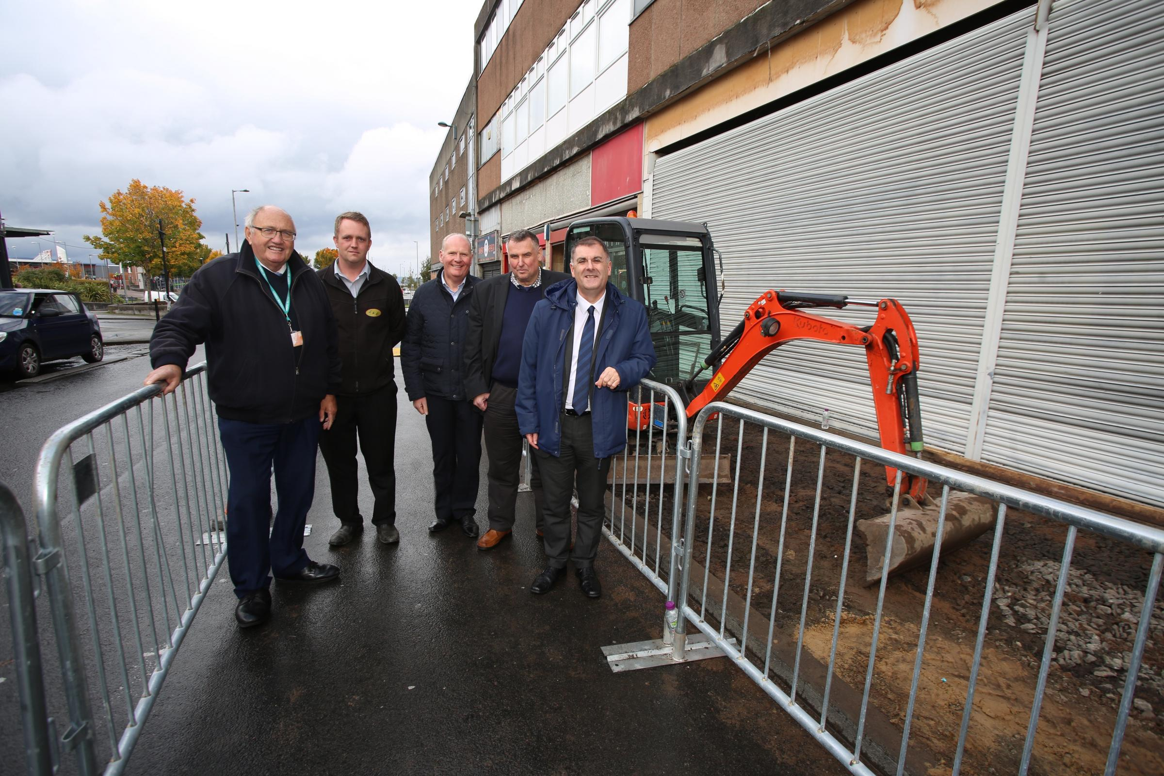Port Glasgow town centre improvements. Work has started on pavement upgrades on Princes Street with roads also being resurfaced at a later date. Pictured from left, Councillor David Wilson, Steven Gray, from contractor Landscapes and Contracts (L&C),