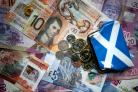 Saltire purse with Scottish bank notes and coins
