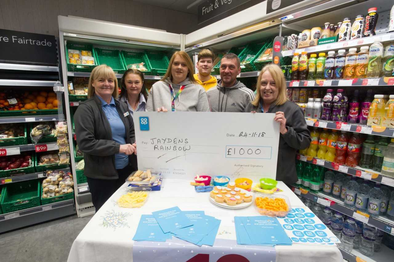 JAYDEN'S RAINBOW: Jayden's dad John, sister Kerri Lynn and brother Declan are over the moon with the money raised by their local Co-op.