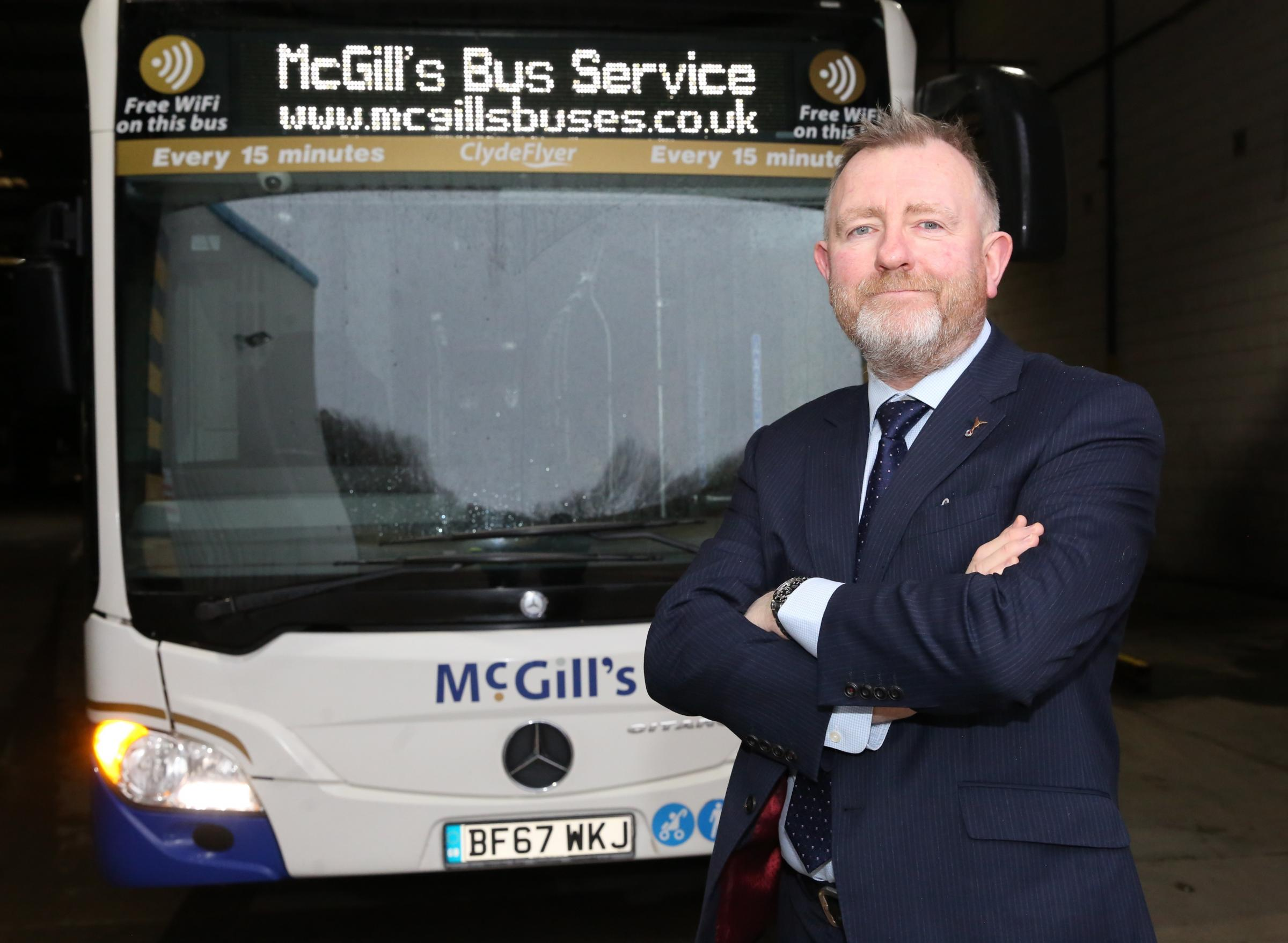 McGill's Buses emissions recognition. Managing director Ralph Roberts is pictured with a low-emissions bus at the company's Greenock headquarters.