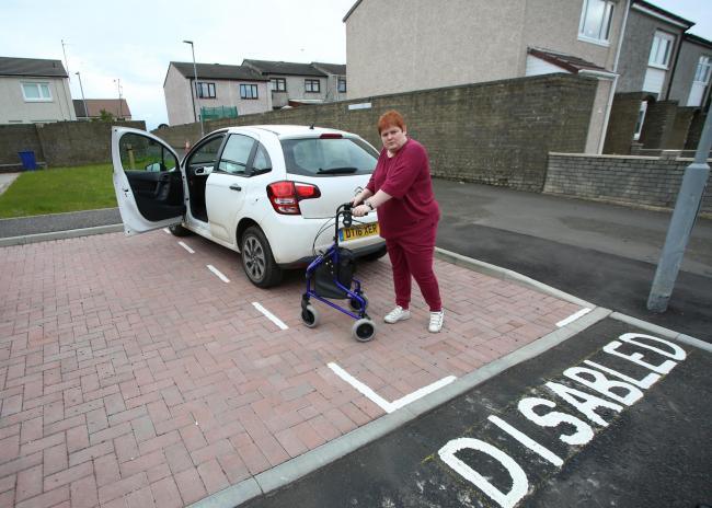 Stacey Reilly disabled parking space is too small..