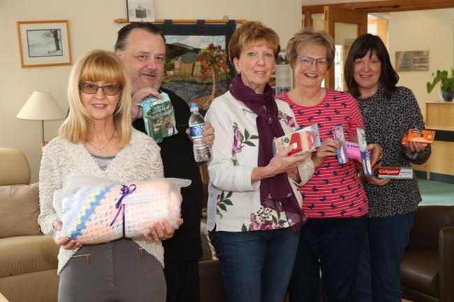 Pictured from left are Compassionate Inverclyde volunteers Margaret Mullan, William Weir, Muriel Searl, Irene Macpherson and Alison Bunce, the founder of Compassionate Inverclyde.